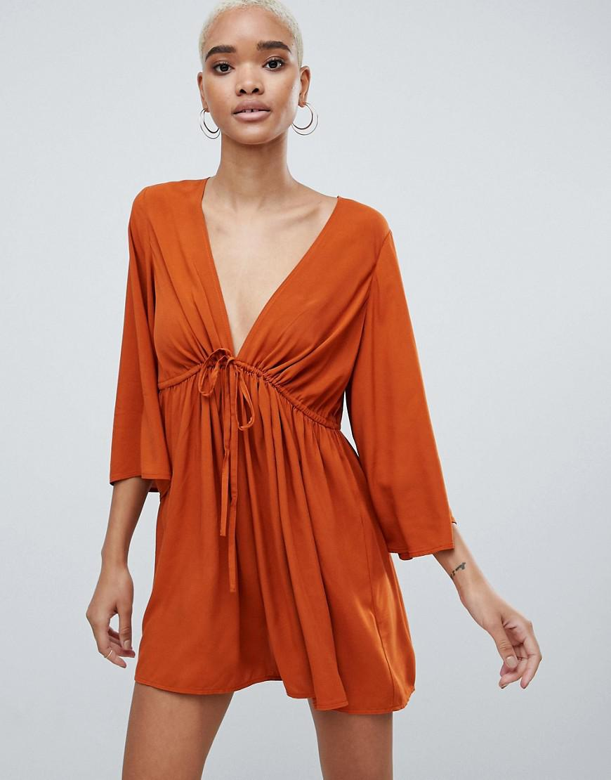 a9ac501cf26 Asos Design Smock Romper With Tie Waist in Red - Lyst