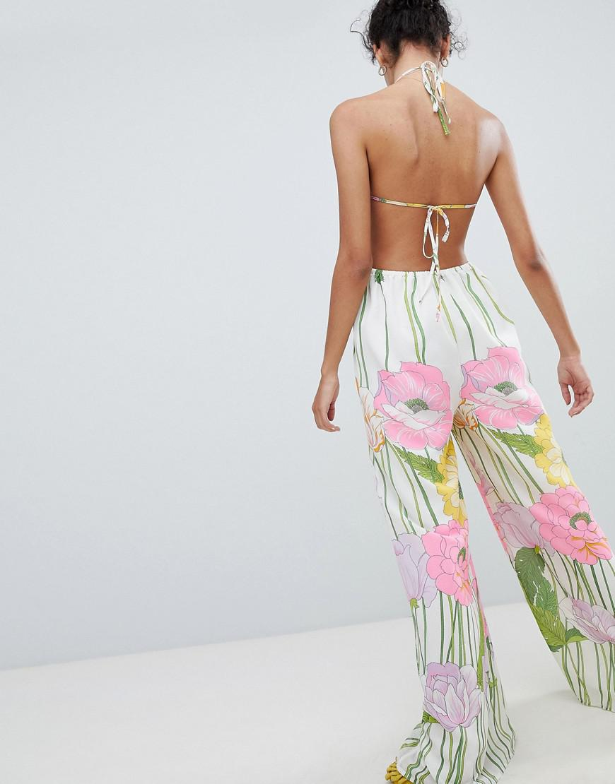 4ad6f2ec3d6 ASOS Jumpsuit With Open Back In 70 s Floral Print - Lyst