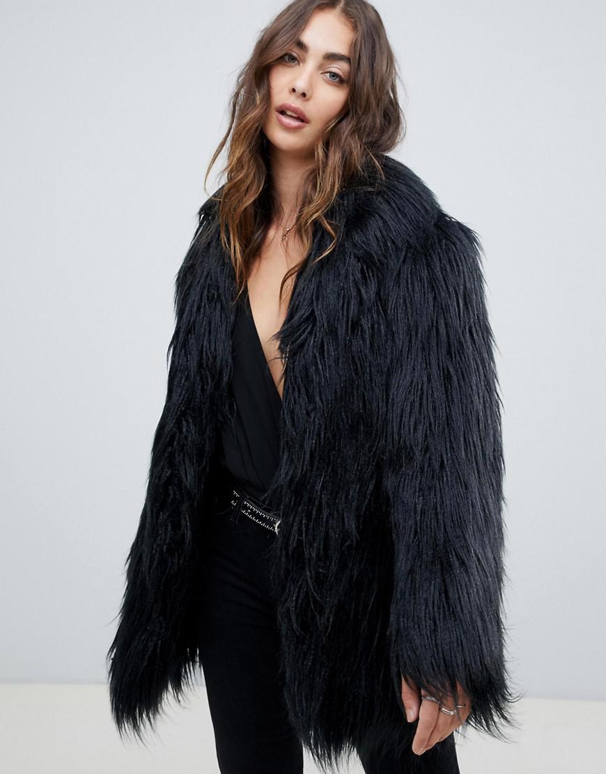 f7c4dbeda53c Religion Mongolian Faux Fur Coat in Black - Lyst