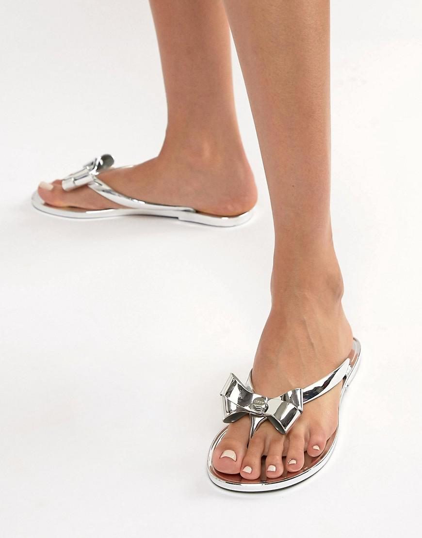 a7ecb4fc335d Lipsy Jelly Sandal With Bow In Metallic in Metallic - Lyst