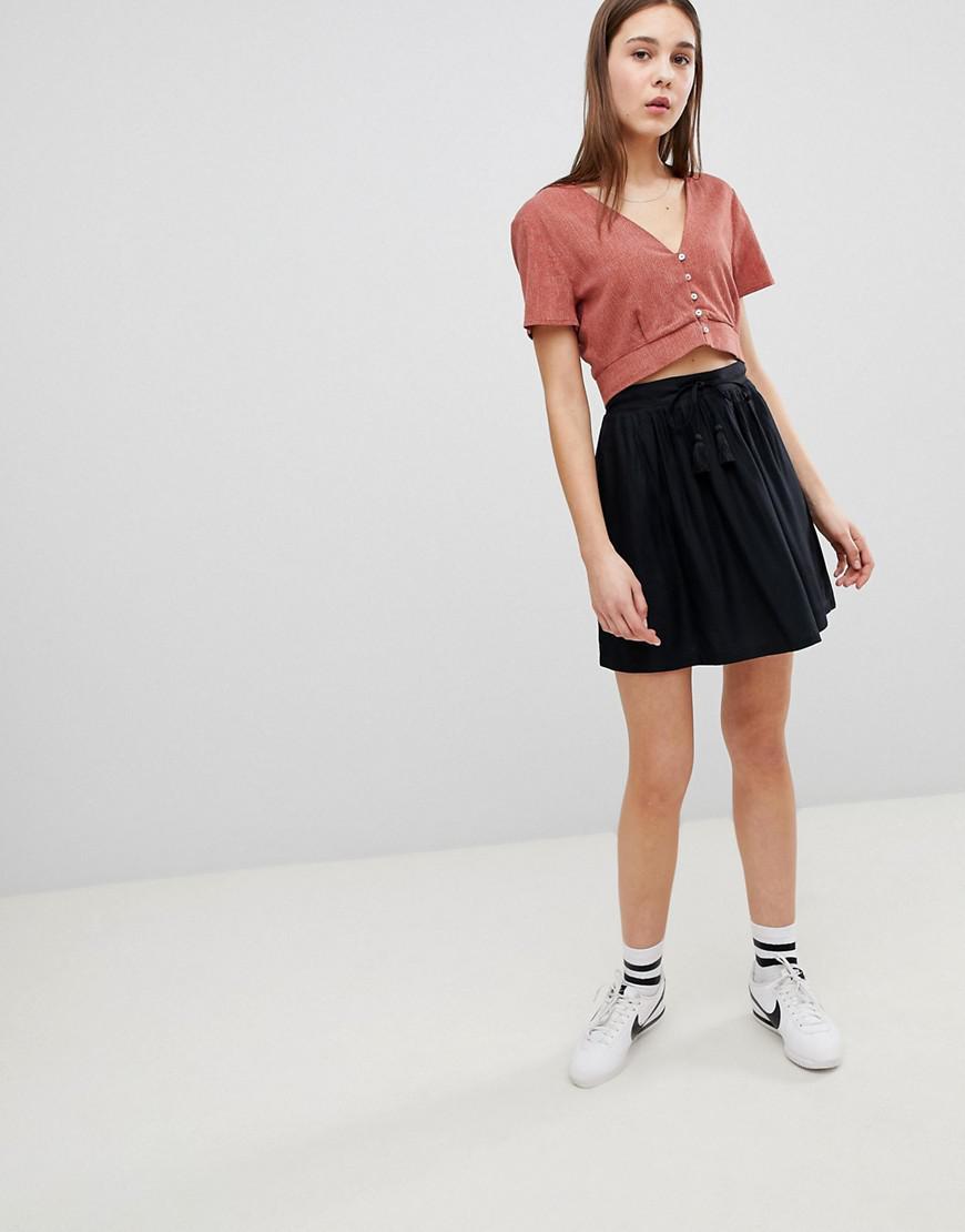 759d6beb1e Mini-jupe avec cordon de serrage Pimkie en coloris Noir - Lyst