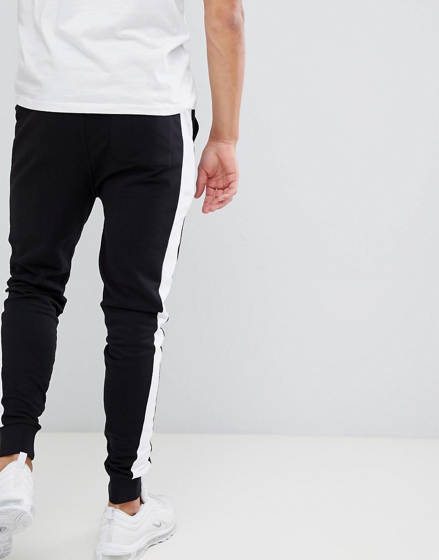 061089646c41 Lyst - Pantalon de jogging ajust avec bande latrale ASOS pour homme en  coloris Noir
