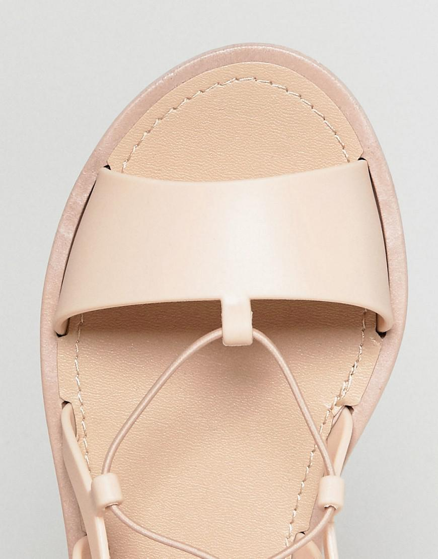 d8e9ad904bd8 Lyst - ASOS Fizzle Wide Fit Jelly Tie Leg Sandals in Natural