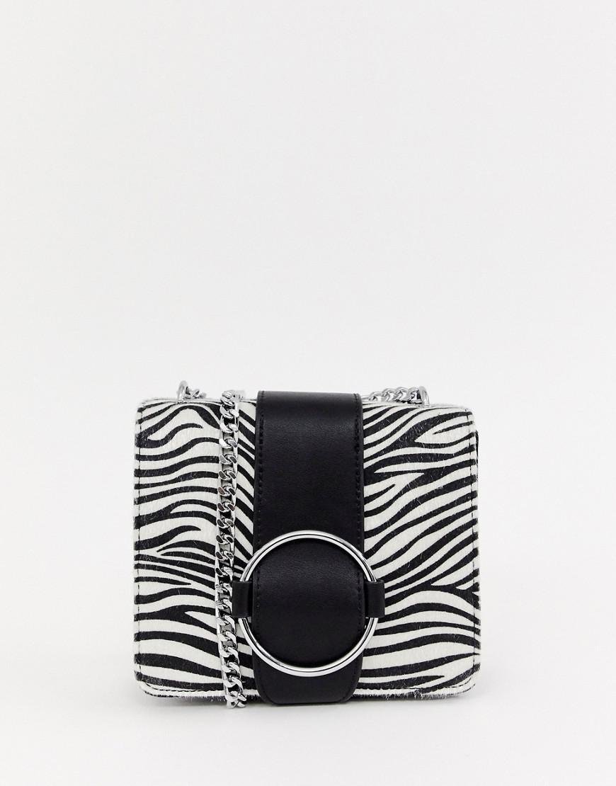 Skinnydip London Faux Zebra Cross Body Bag With Chain Detail in ... b8c3b301126da