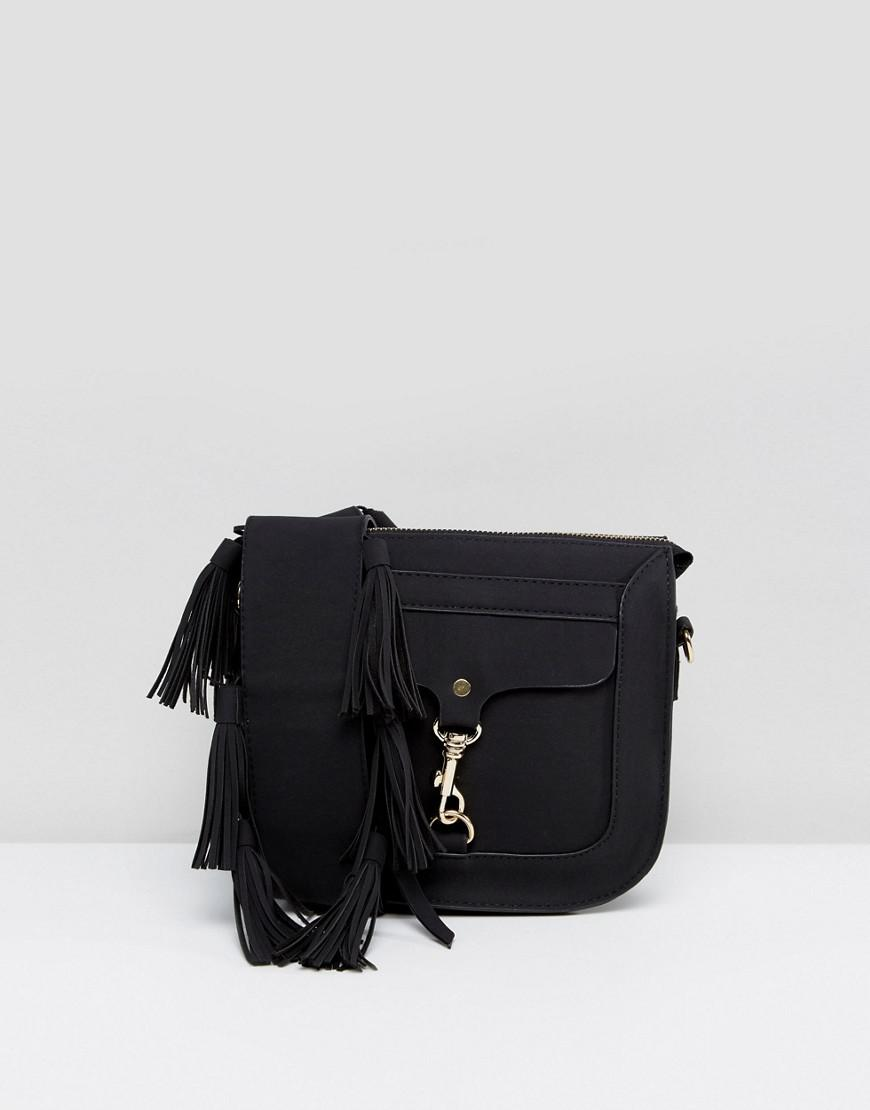 7a795c6e12 Lyst - Yoki Fashion Saddel Bag With Buckle Detail in Black
