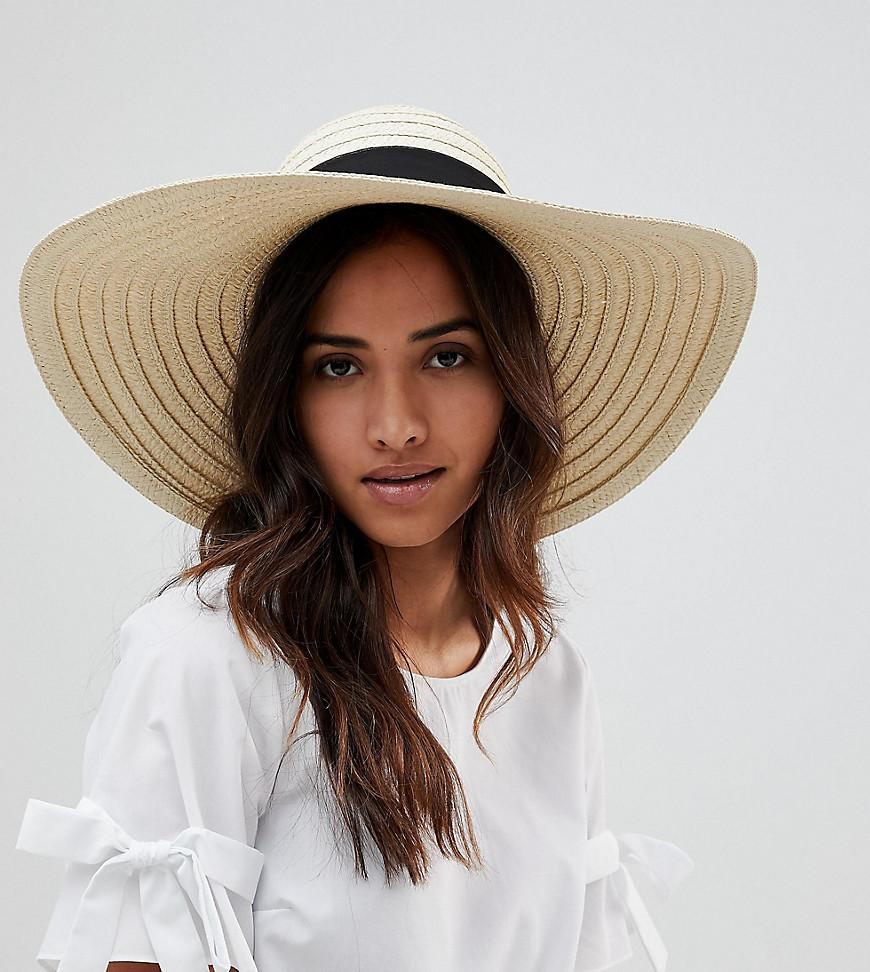 213b49e63f8 South Beach Oversized Bow Straw Hat in Natural - Lyst