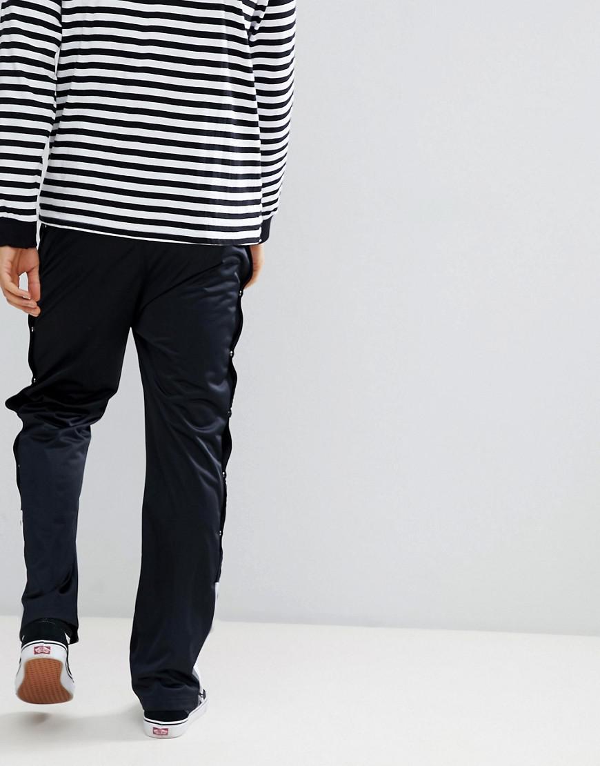 Pantalon de jogging en maille de polyester avec boutons pression Champion pour homme en coloris Black