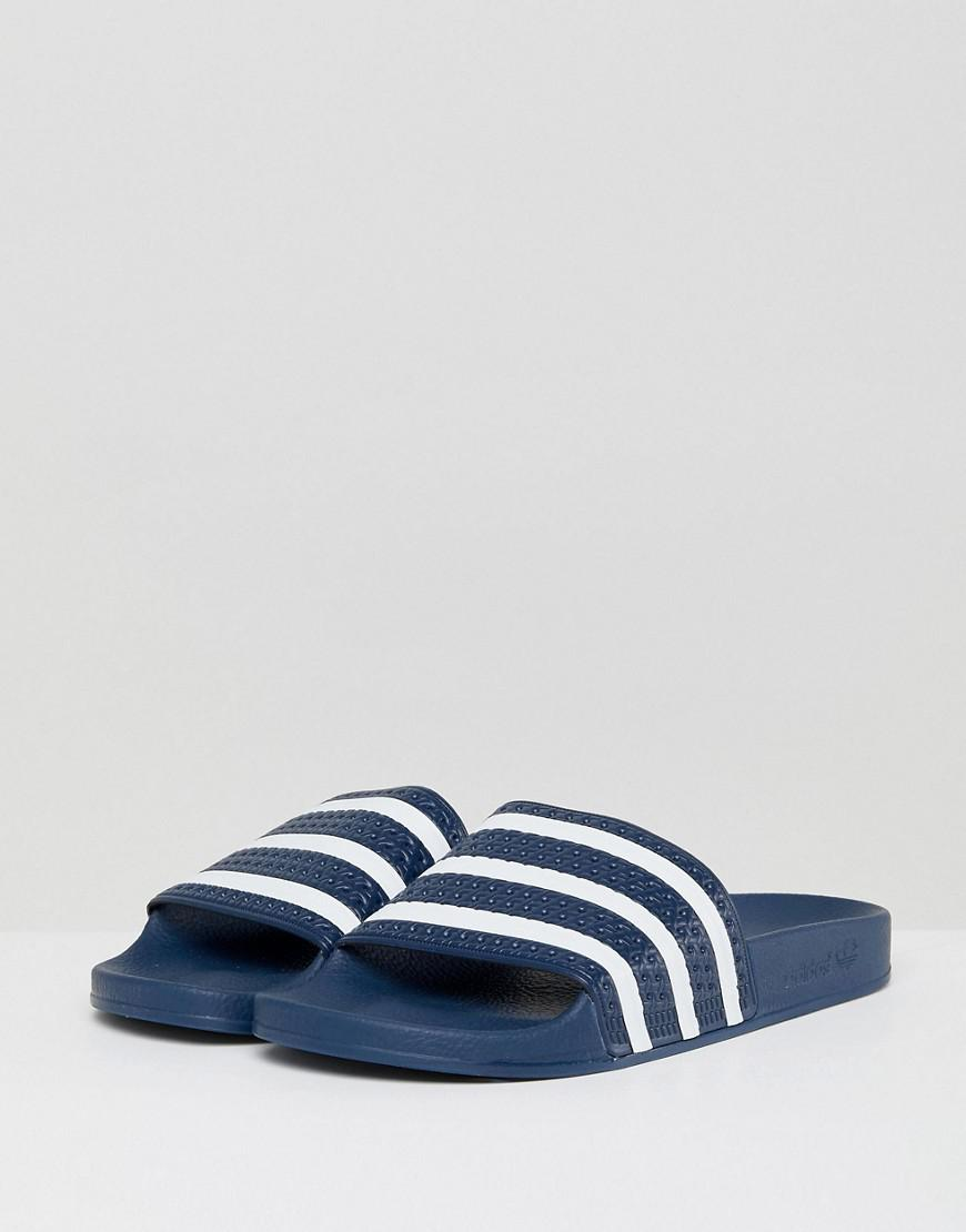 fb83e6e0bfd682 Lyst - adidas Originals Adilette Sliders In Navy 288022 in Blue for ...