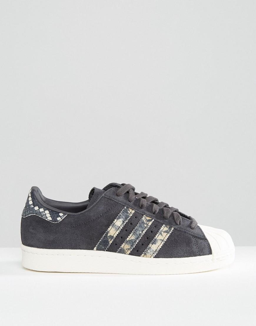 new arrivals 3bcb3 c1bda ... coupon for lyst adidas superstar suede and snakeskin sneakers in black  437ee 4ff4e