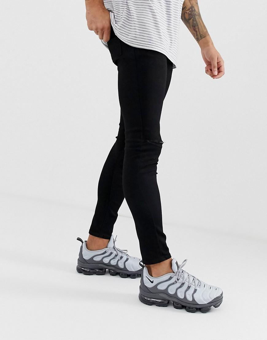ce9c522142921 ASOS Spray On Jeans In Power Stretch Denim In Black With Knee Rip in Black  for Men - Lyst