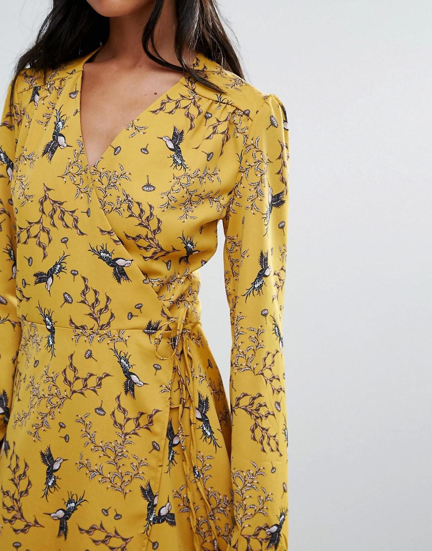 Liquorish Swallow Print Wrap Front Long Sleeve Dress In