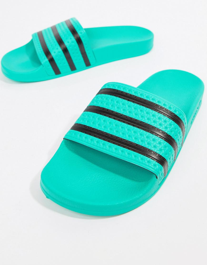 72c78b846cfb adidas Originals Adilette Slides in Green for Men - Lyst