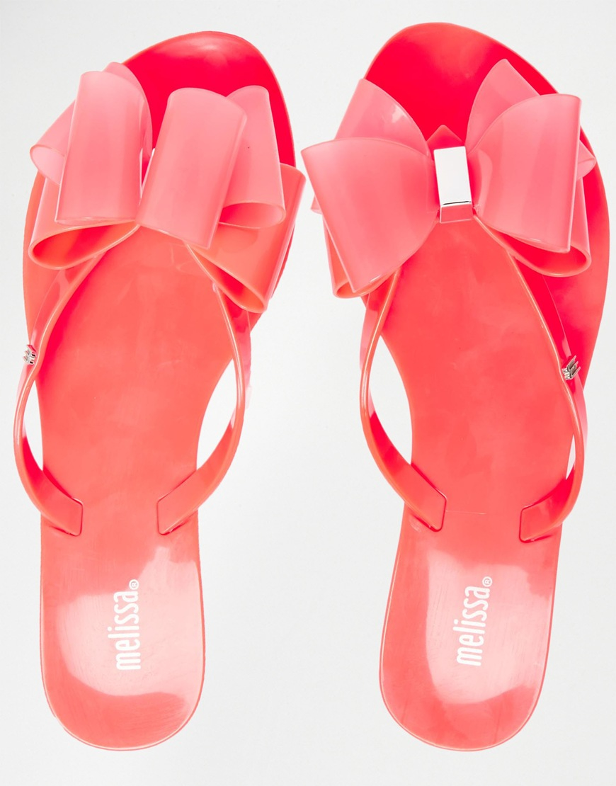 60ea08fa844b9 Lyst - Melissa Harmonic Orange Twin Bow Flip Flops in Red