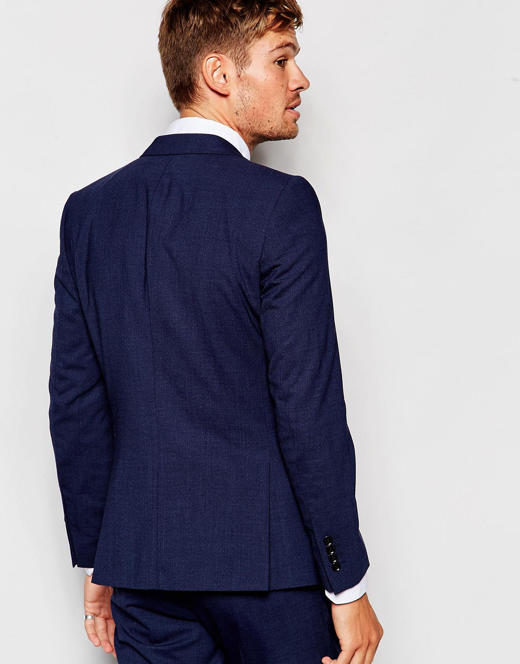 how to pack a suit jacket for travel