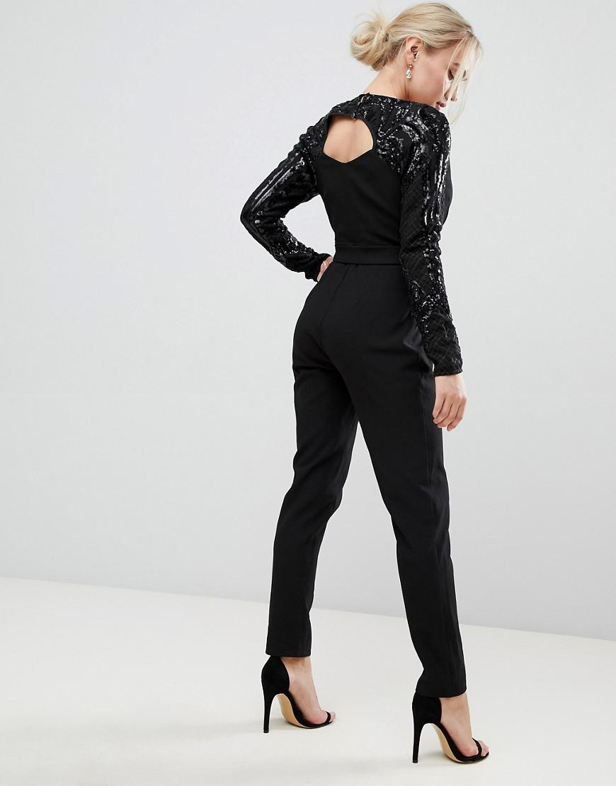 ec181d43c3f2 Lyst - Little Mistress Wrap Front Jumpsuit With Sequin Sleeves And Exposed  Back in Black