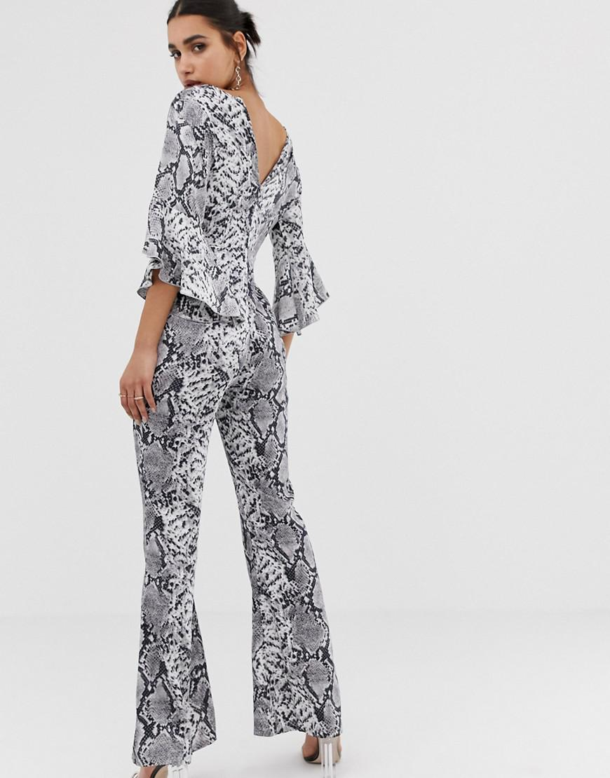 46706dd268f7 PrettyLittleThing Flared Sleeve Jumpsuit In Grey Snake in Gray - Lyst