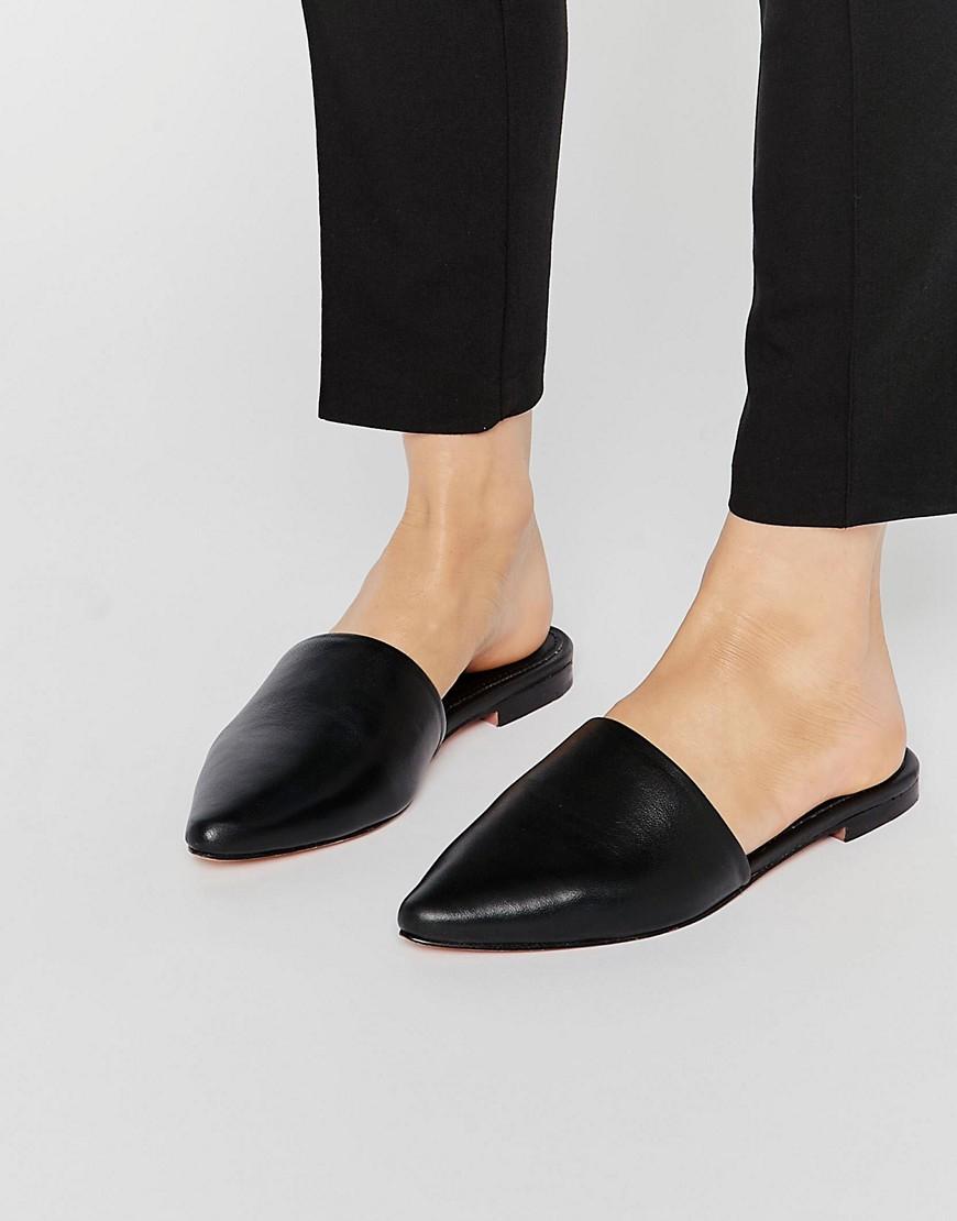 lyst warehouse slip on mules black in black
