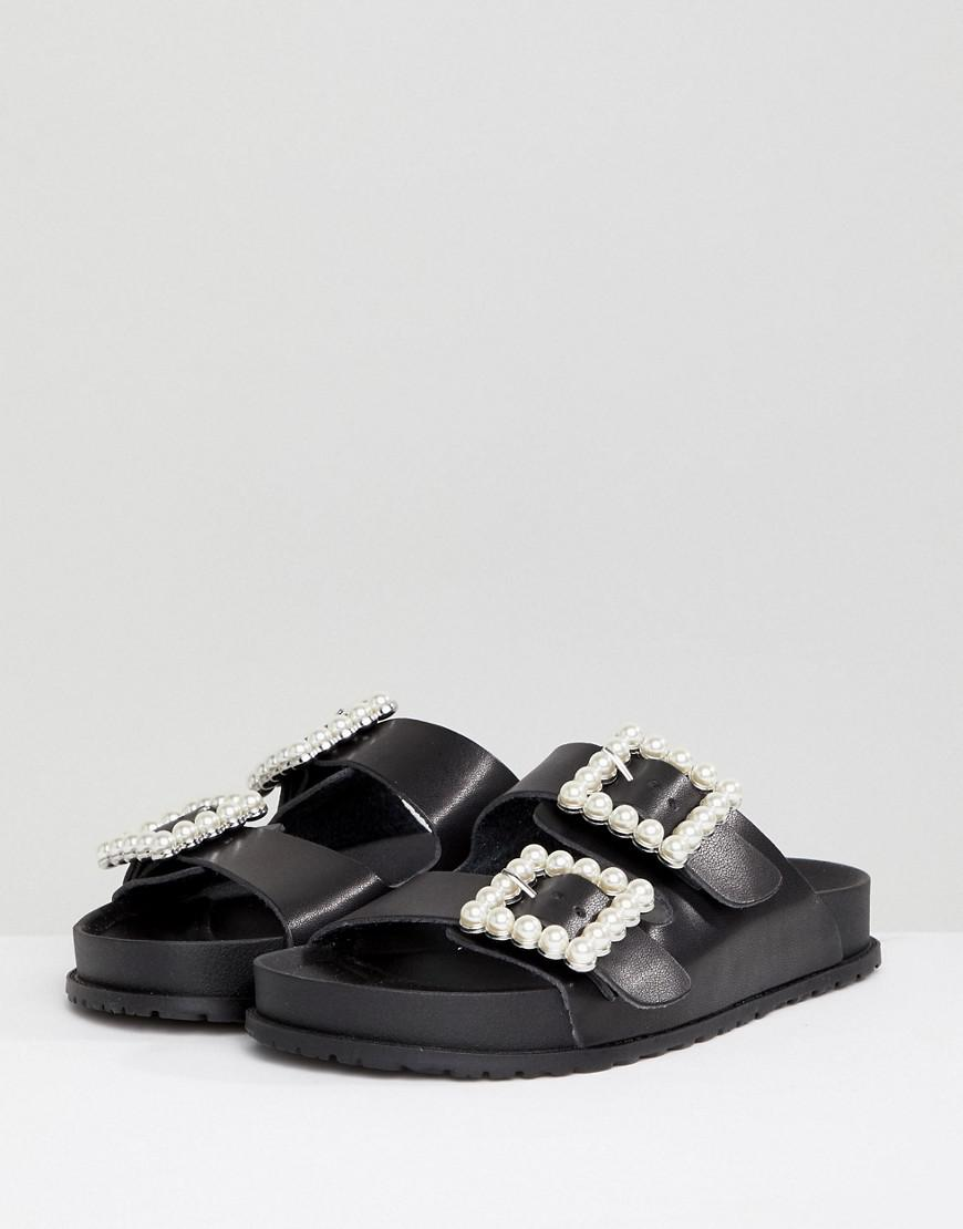 new product 20be8 e2833 ... get online Steve Madden Nora Pearl Buckle Sliders in Black - Lyst 9df68  f33a3 ...