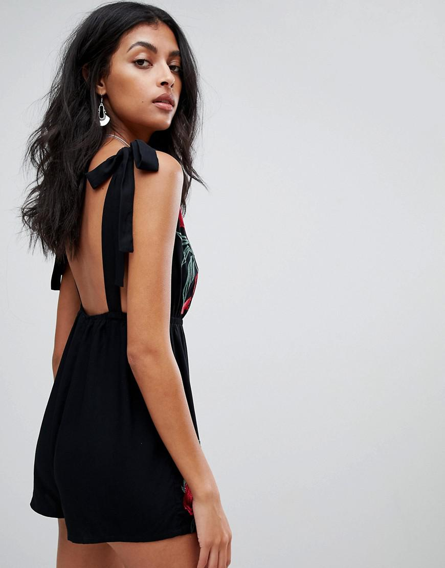 d61c051296de Lyst - ASOS Western Floral Embroidered Plunge Beach Playsuit in Black