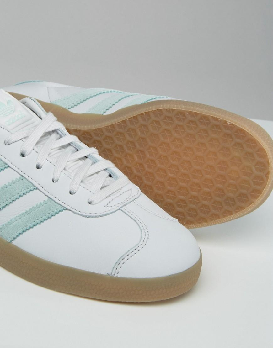 adidas originals iniki trainers in white and mint