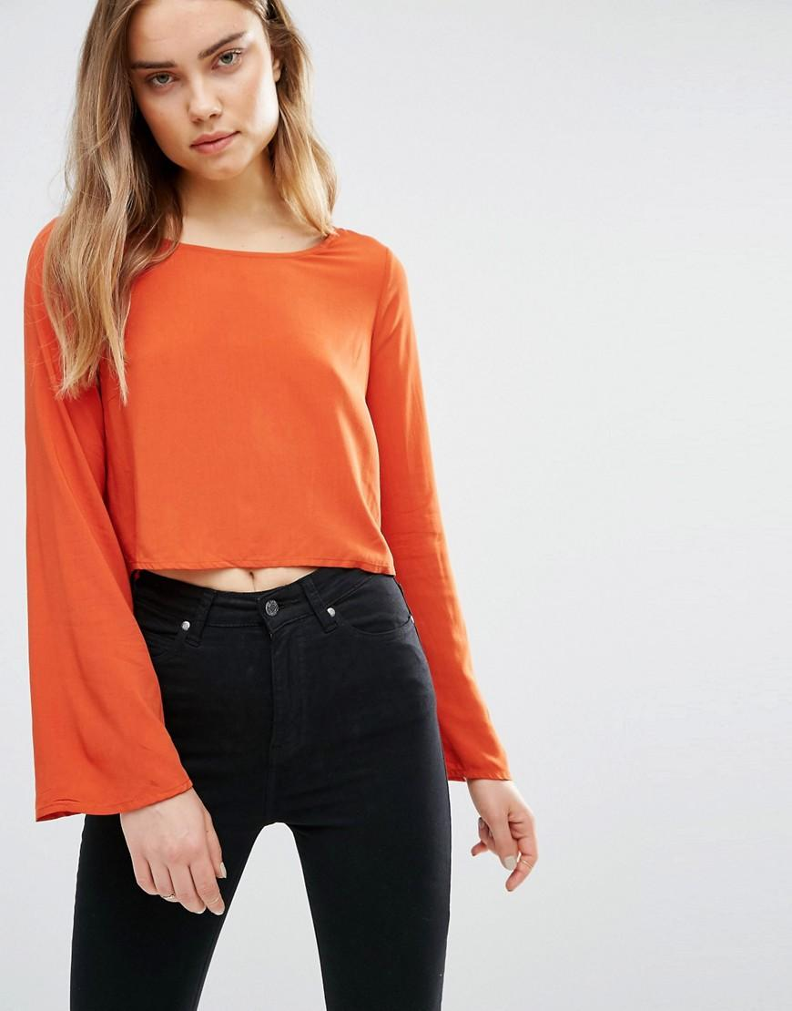 First Amp I Open Back Blouse With Lace Up Waist In Orange Lyst
