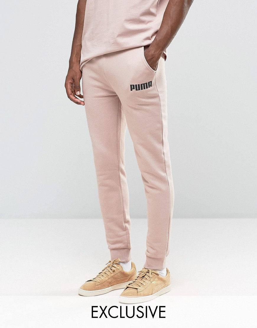lyst puma joggers in tapered fit exclusive to asos in. Black Bedroom Furniture Sets. Home Design Ideas