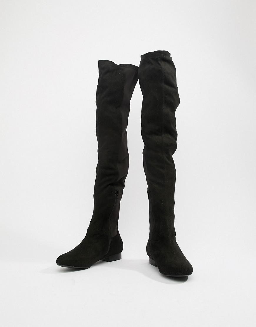 c977b34f6ff Lyst - ASOS Wide Fit Kelby Flat Elastic Thigh High Boots in Black
