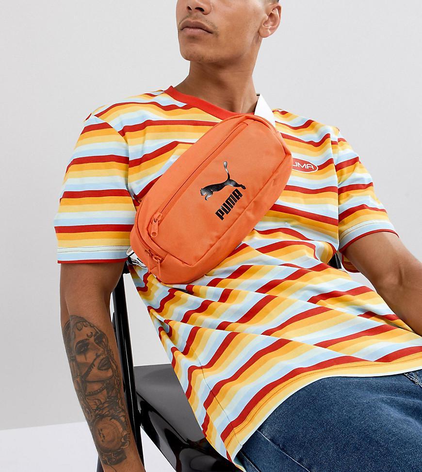 7e89cbed4b02 PUMA Bumbag In Orange Exclusive At Asos in Orange for Men - Lyst