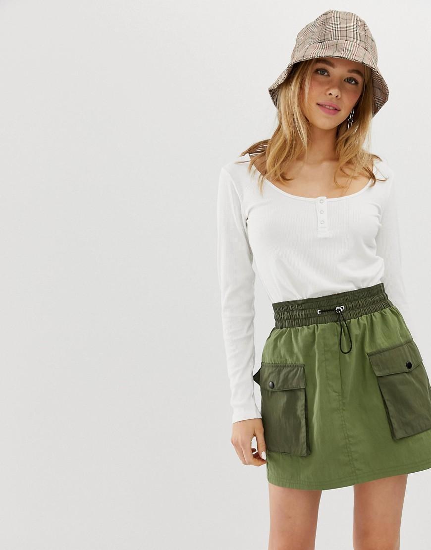 a6d5f3f12d64 Lyst - Bershka Patched Mini Skirt In Green in Green