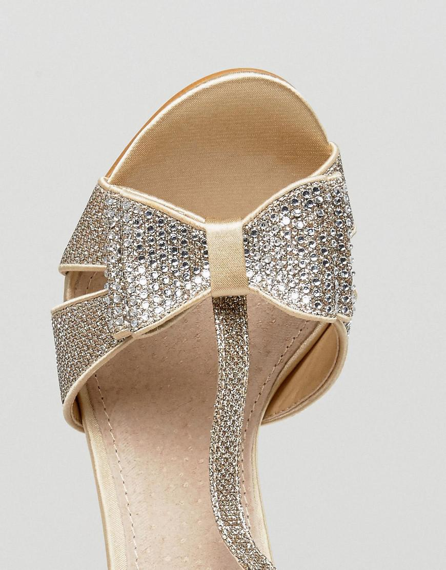 3c16bcd32b70 True Decadence Gold Glitter Bow Heeled Sandals in Metallic - Lyst