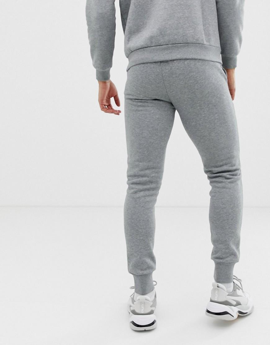 105e66de4c03 Lyst - PUMA Essentials Skinny Fit joggers In Grey in Gray for Men - Save 22%