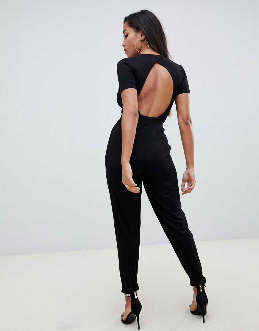 8ef5375ab3f Lyst - ASOS Asos Design Petite Wrap Front Jersey Jumpsuit With Short Sleeve  in Black