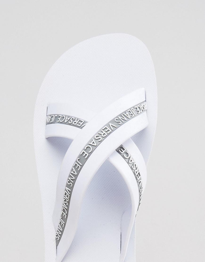 c8008580e Lyst - Versace Jeans Jeans Logo Crossover Flip Flop in White for Men