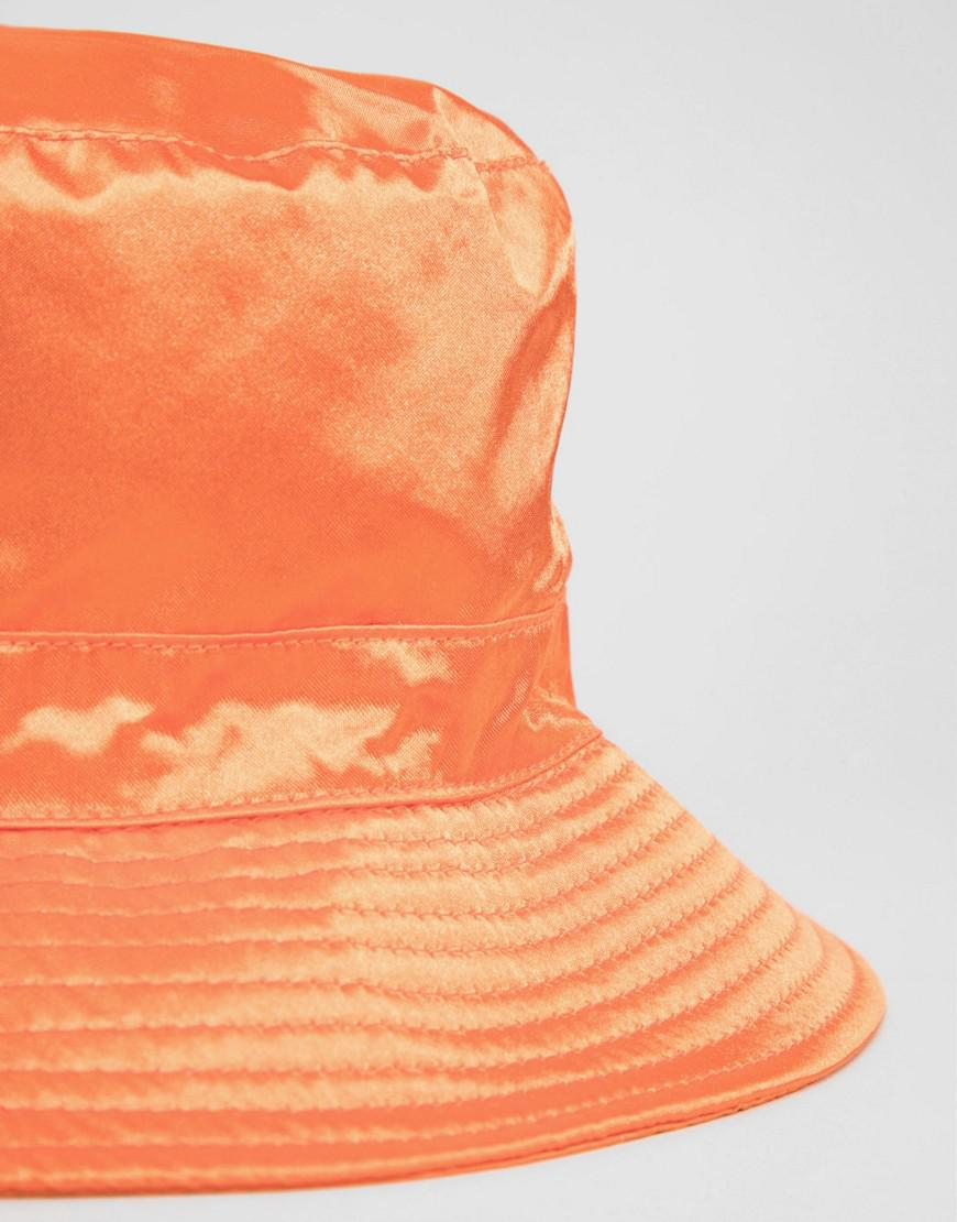 4c221fc8573 Lyst - ASOS Satin Bucket Hat in Orange