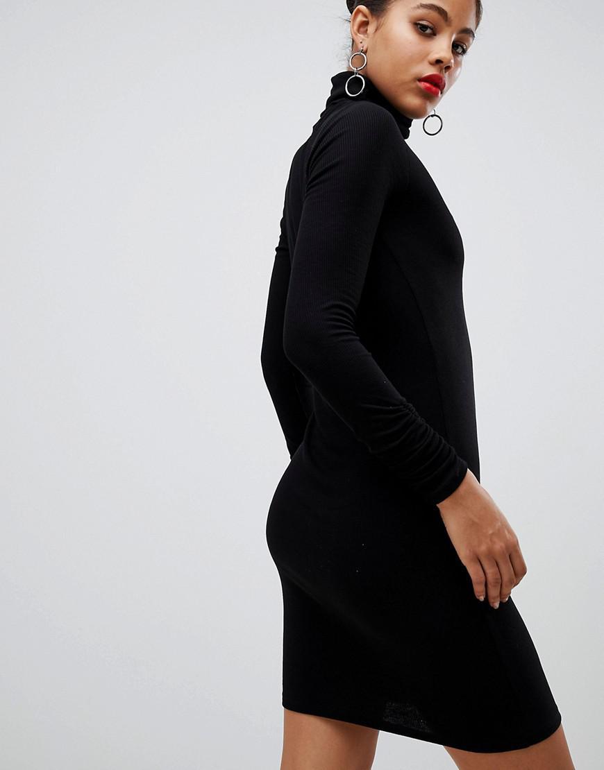 2cc255620b Lyst - ASOS Asos Design Tall High Neck Rib Bodycon Mini Dress With Long  Sleeves in Black