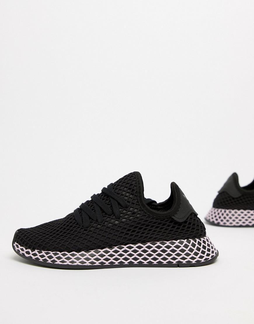 lyst adidas originali deerupt scarpe in nero e lilla in nero