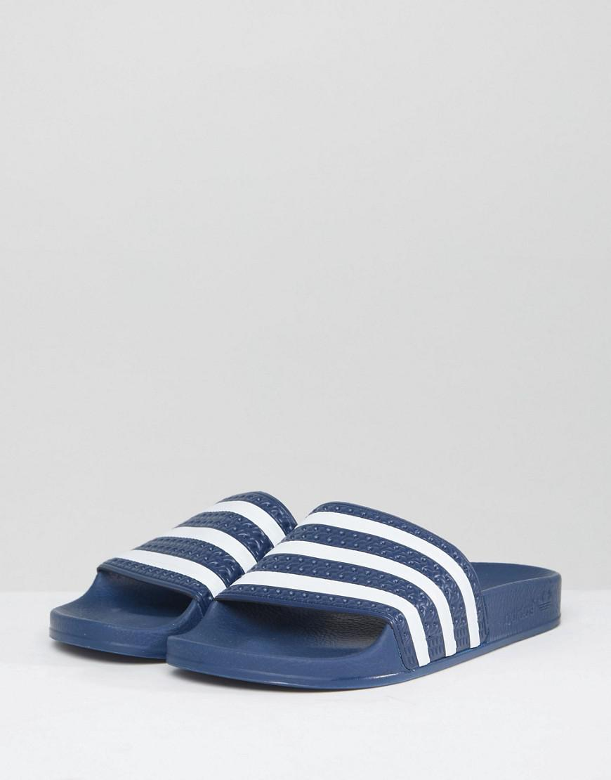 52fe044a86949 Lyst - adidas Originals Adilette Slider Sandals In Navy And White in Blue