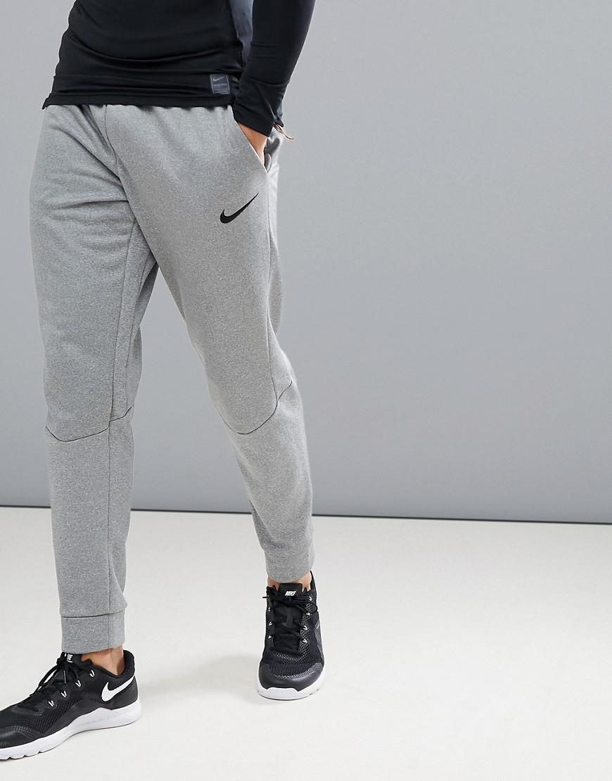 Nike. Men's Gray Therma Tapered Joggers In Grey 800193-091