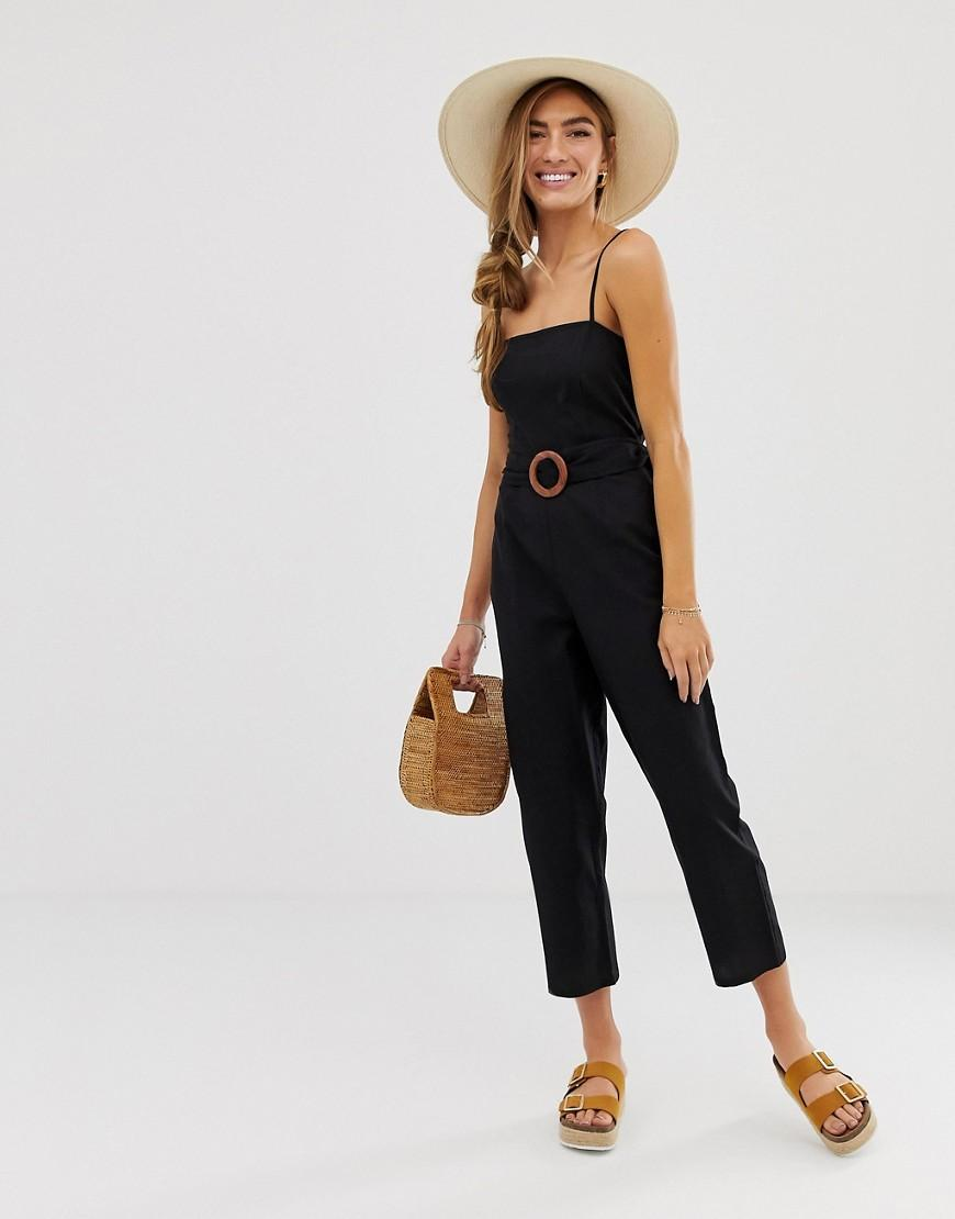 fd6e0715fbd Lyst - ASOS Strappy Pinny Belted Jumpsuit in Black