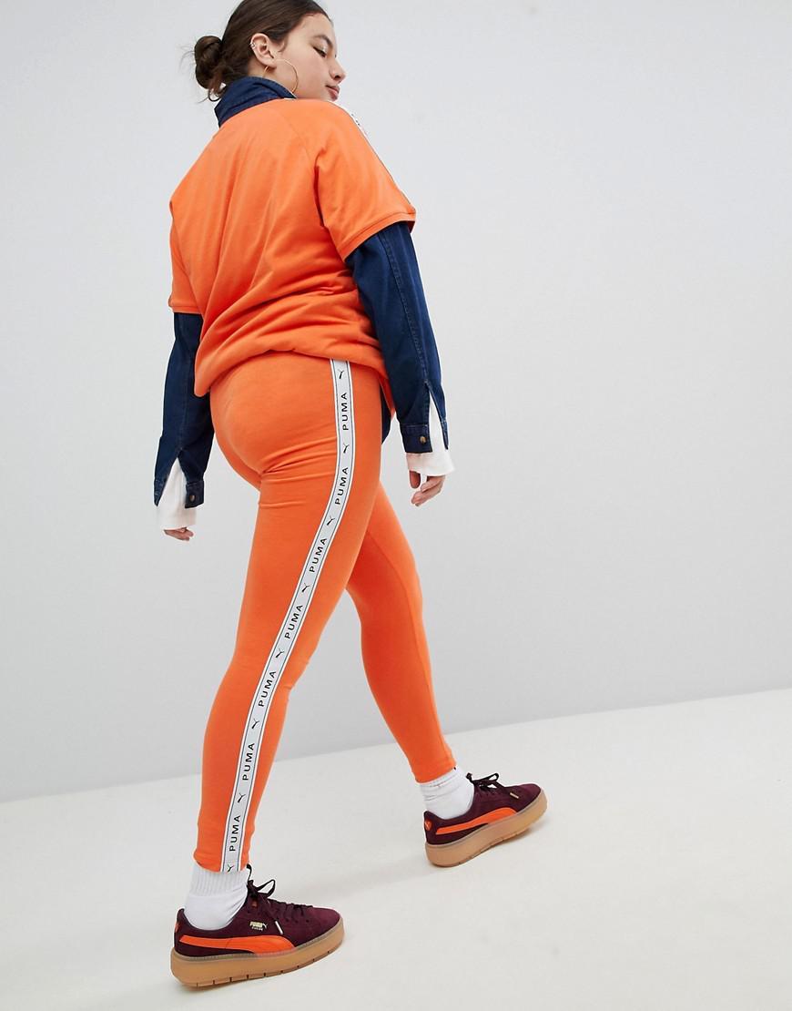 3f28d6035c8691 PUMA Exclusive To Asos Plus Taped Side Stripe Leggings In Orange in Orange  - Lyst
