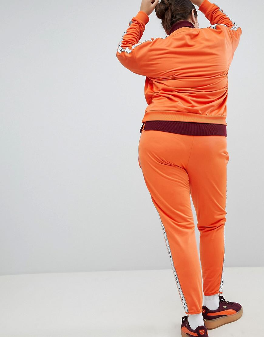 039e27ef893 Lyst - PUMA Exclusive To Asos Plus Taped Side Stripe Track Pants In Orange  in Orange