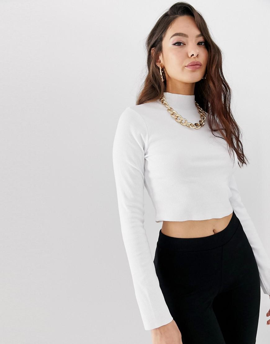 0fd30d9f8ea Lyst - ASOS Long Sleeve Crop Top With Turtle Neck And Raw Hem In Rib ...