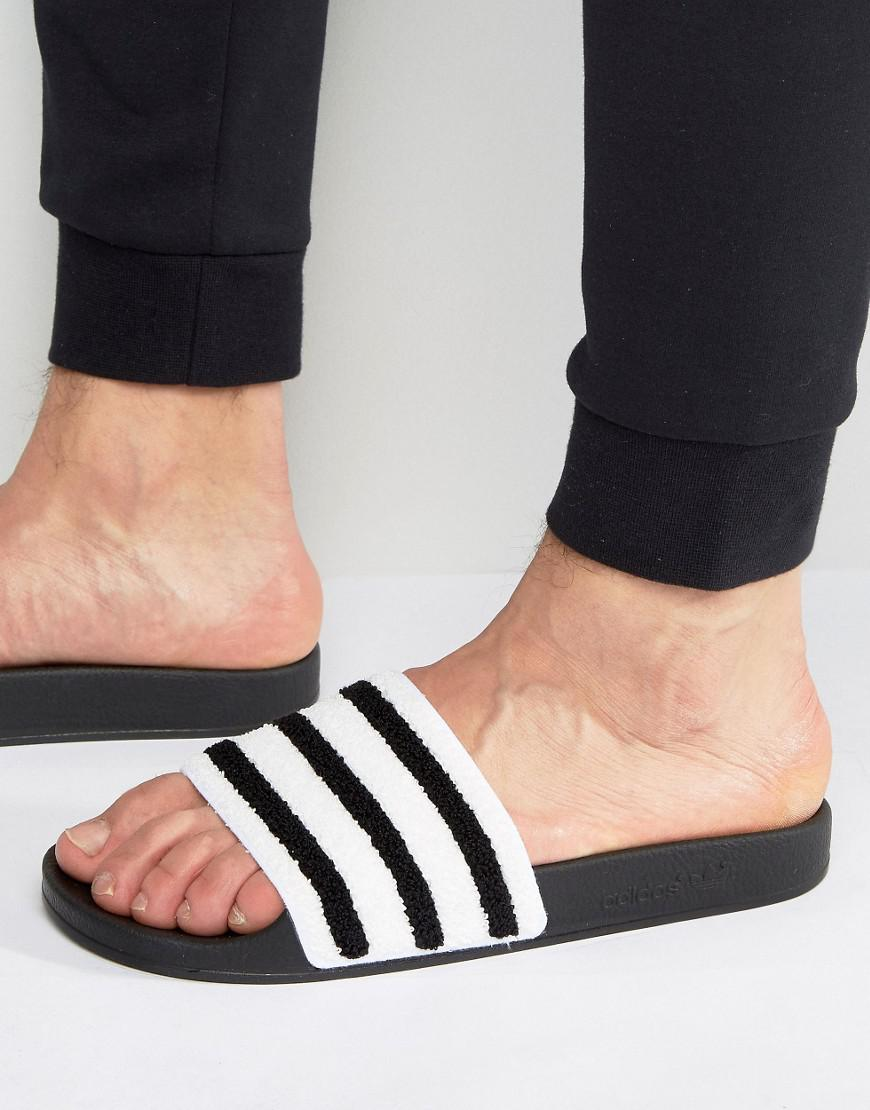 1eaea630e9029 adidas Originals Adilette Stripe Slides in Black for Men - Save 66 ...