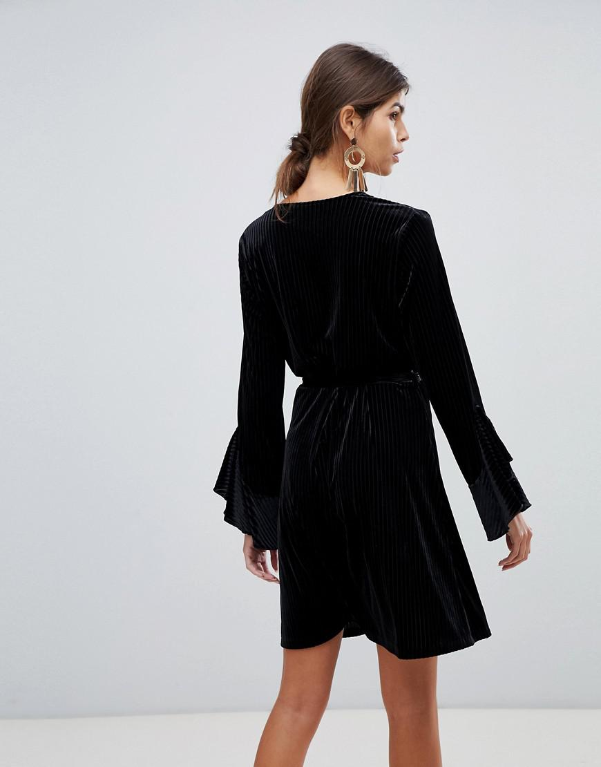 e97da7be43 Lyst - Vila Velvet Sleeve Ruffle Wrap Dress in Black