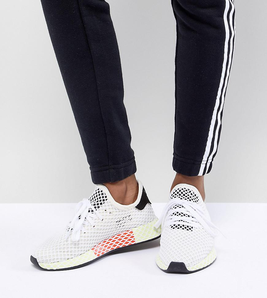 ca77f3387 adidas Originals Deerupt Runner Sneakers In White And Yellow in ...