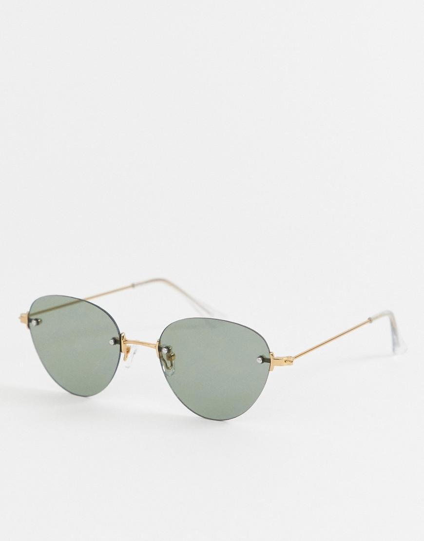 7a735acfef Gafas de sol con montura redonda en dorado brillante y lentes al ...