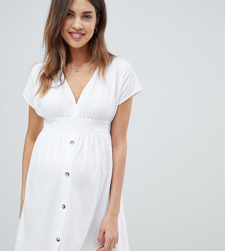 d7165081cb1 ASOS. Women s White Asos Design Maternity Mini Dress With Belt And Faux Tortoiseshell  Buttons