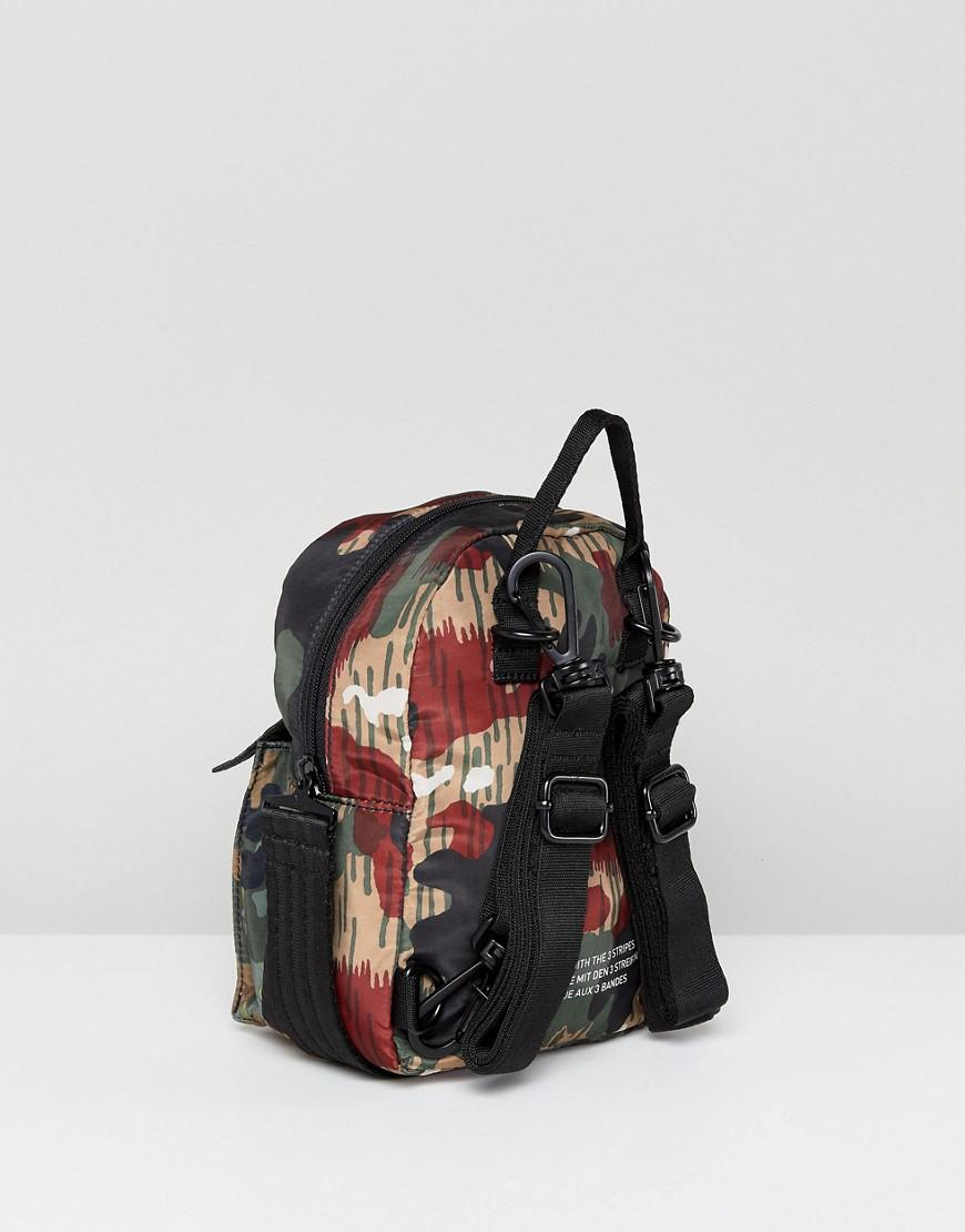 53747a3b87ad Lyst - adidas Originals X Pharrell Williams Hu Camo Mini Backpack