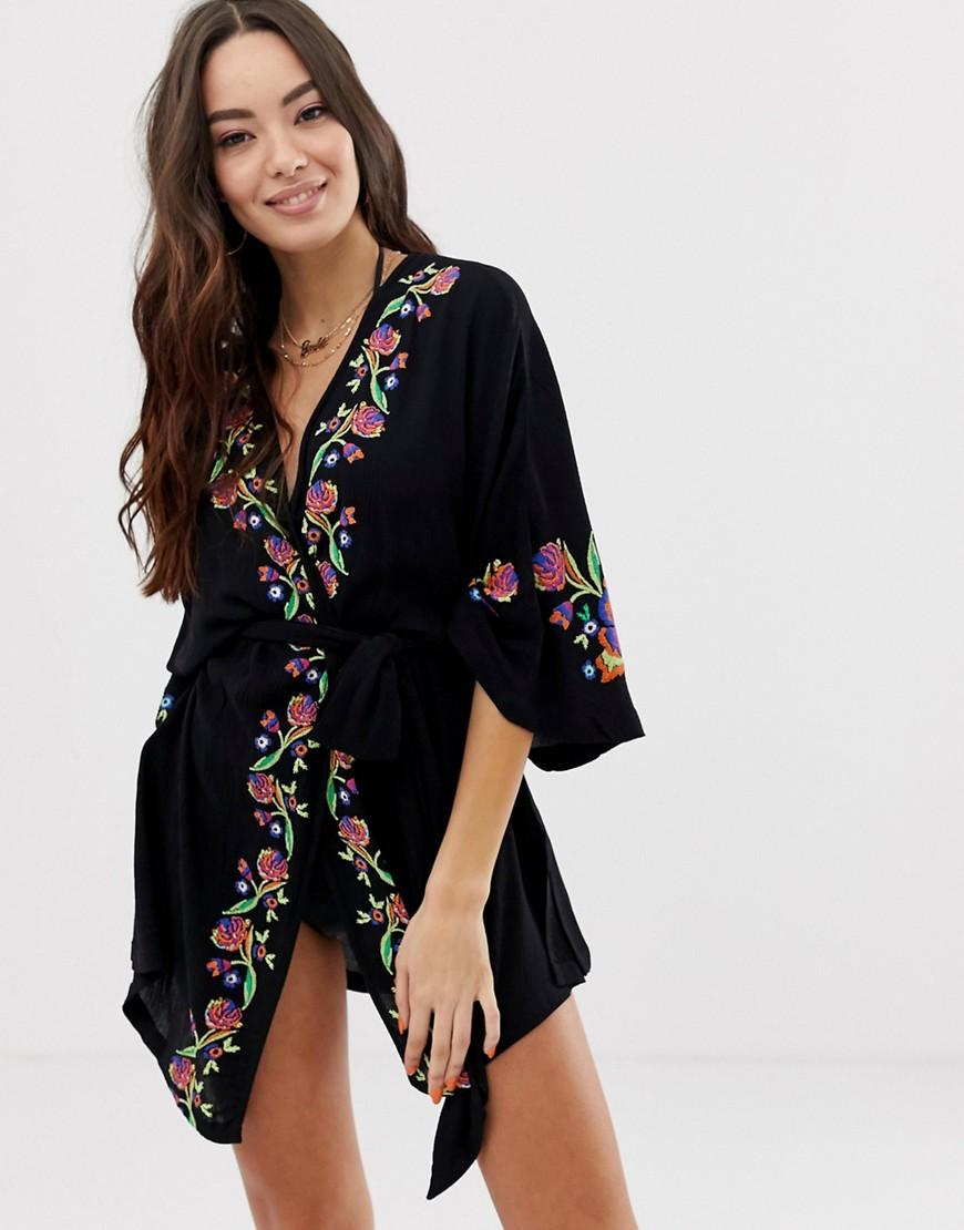 5cc400913a7 Lyst - ASOS Wrap Front Beach Cover Up With Floral Embroidery Print ...