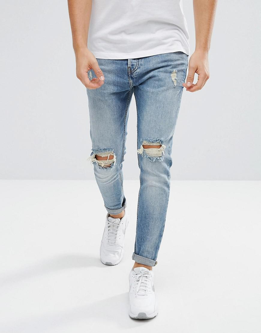 88cea6089de Pull&Bear Ripped Jeans In Carrot Fit In Mid Wash Blue in Blue for ...